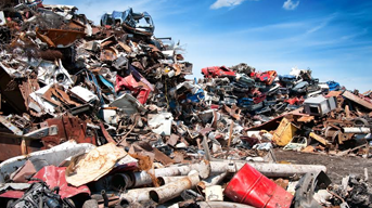 Iron scrap metal compacted to responsible waste management
