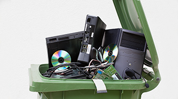 old electronics computer parts trash in recycle bin